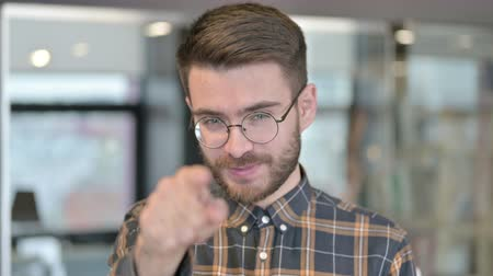příležitost : Portrait of Young Designer Pointing Finger and Inviting