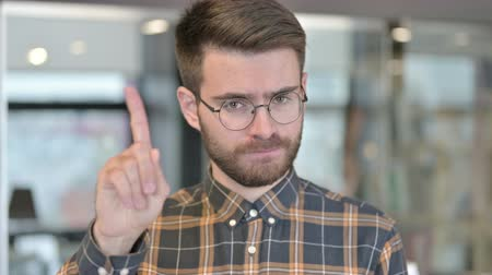 elválasztás : Portrait of Young Designer saying No with Finger Gesture