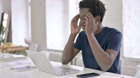 etnia africano : Young African Man having Headache in Office Stock Footage