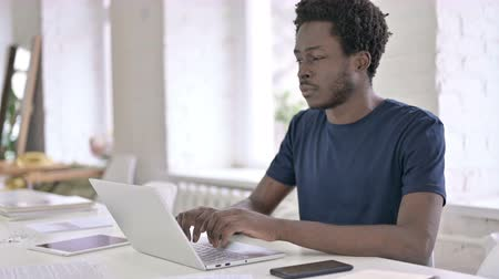 introspection : Young African Designer Thinking and Working on Laptop