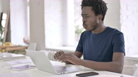 hardworking : Hardworking Young African Designer Having Failure on Laptop Stock Footage