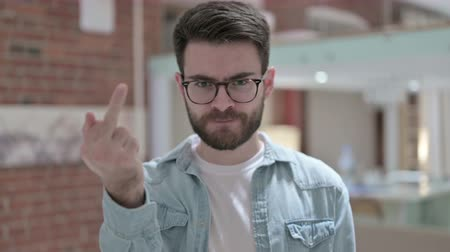 adults only : Portrait of Angry Young Male Designer Showing Middle Finger Stock Footage