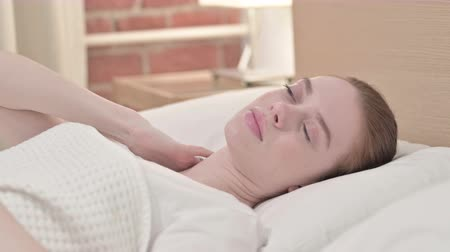 physical pressure : Sleeping Redhead Young Woman having Neck Pain in Bed Stock Footage