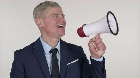 мегафон : Announcing Senior Businessman Shouting Through a Megaphone, White Background