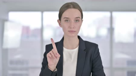 só as mulheres jovens : Portrait of Attractive Young Businesswoman saying No by Finger