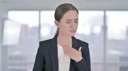 coughing : Portrait of Sick Young Businesswoman Coughing