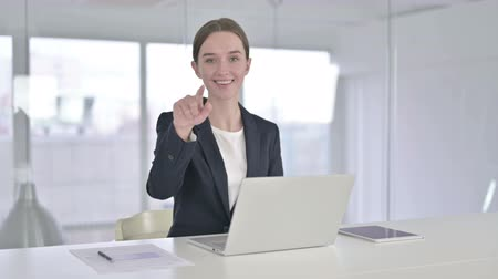 beckoning : Cheerful Young Businesswoman Pointing at the Camera Stock Footage