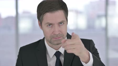 beckoning : Portrait of Middle Aged Businessman Pointing Finger and Inviting Stock Footage