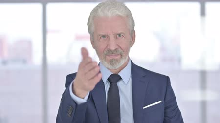 beckoning : Portrait of Old Businessman Pointing Finger at Camera and Inviting Stock Footage