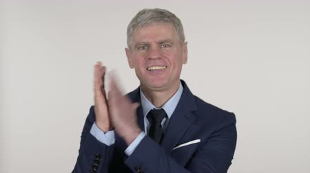 admiracion : Clapping Senior Businessman Applauding on White Background Archivo de Video