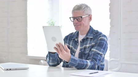 hardworking : Hardworking Casual Middle Aged Man Using Tablet