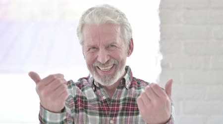 beckoning : Portrait of Inviting Old Male Designer Pointing Finger at Camera