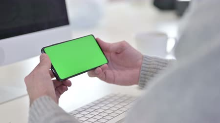 one man only : Watching Video on Chroma Key Screen Smartphone