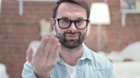 merging : Portrait of Beard Young Man Pointing Finger and Inviting Stock Footage