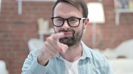 merging : Portrait of Cheerful Beard Young Man Pointing Finger at the Camera Stock Footage