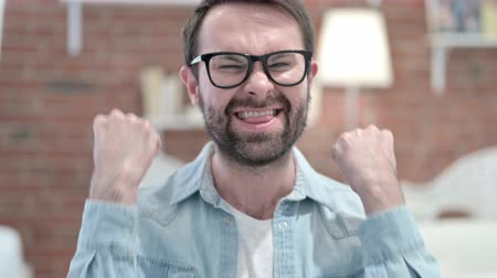 adults only : Portrait of Cheerful Beard Young Man Celebrating Success Stock Footage