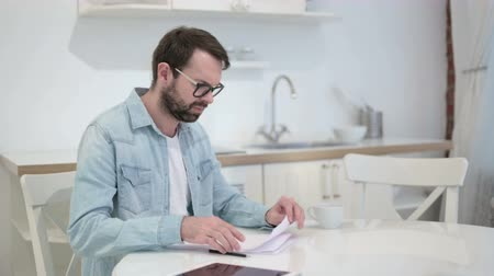 banking document : Focused Beard Young Man Reacting to Failure on Documents