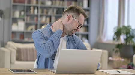 hardworking : Hardworking Young Man having Neck Pain in Loft Office