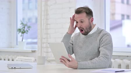 distraught : Upset Creative Man Reacting to Failure on Tablet Stock Footage