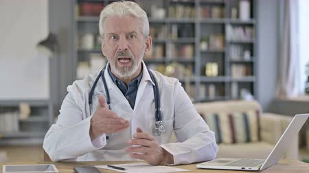 counsel : Senior Old Doctor doing Consultation with Patient, Video Chat Stock Footage