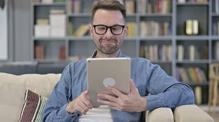 a böngésző : Portrait of Cheerful Young Designer doing Video Chat on Tablet