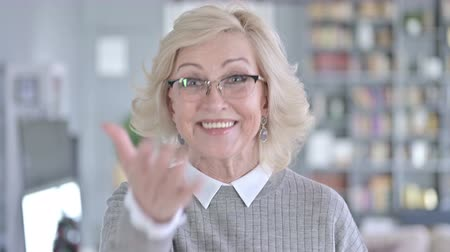 merging : Portrait of Beautiful Old Woman Pointing Finger and Inviting