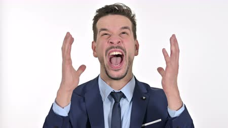 gritar : Portrait of Angry Young Businessman Shouting, White Background Vídeos