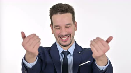 señalando : Portrait of Young Businessman Pointing Finger and Inviting, White Background Archivo de Video