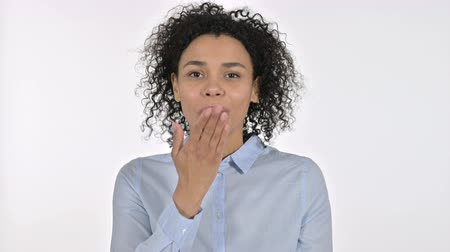 white out : Portrait of Attractive Young African Woman giving Flying Kiss