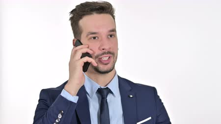 gritar : Portrait of Upset Young Businessman getting Angry on Smartphone , White Background