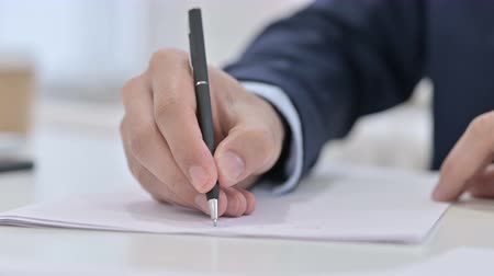 escritor : Busy Businessman Writing on Paper, Paperwork
