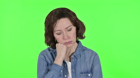 adversidade : Tired Old Woman taking Nap on Green Chroma Key Background