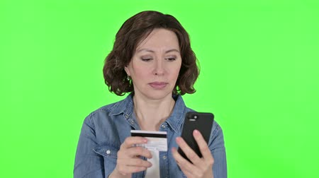waluta : Online Payment on Smartphone by Old Woman, Green Chroma Key Background