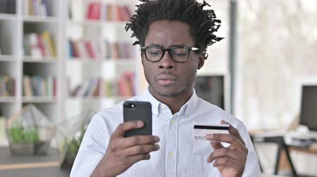 waluta : African Man having Online Payment Failure on Smartphone