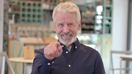 merging : Portrait of Attractive Old Man Pointing with Finger