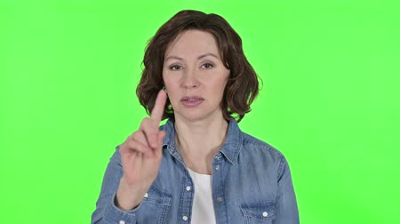 sallama : No, Finger Sign by Old Woman on Green Chroma Key Background