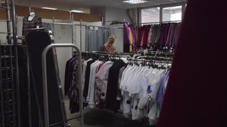 video woman in clothing store