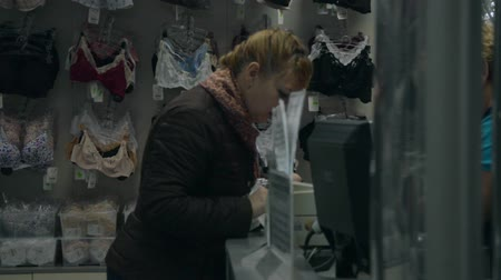 undershirt : video Women Choose Underwear In A Clothing Store Close-Up Stock Footage