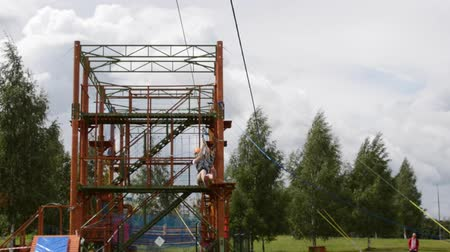 obstacles : HD A girl passes the obstacle course ride