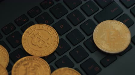 капелька : golden and silver bitcoins on keyboard, extreme close-up, dolly shot