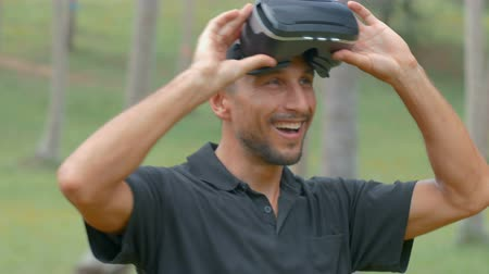 senhor : Man using virtual reality headset in the jungle Stock Footage