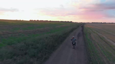 крайняя местности : Aerial view, motocross rider riding on his motorcycle on the off-road track