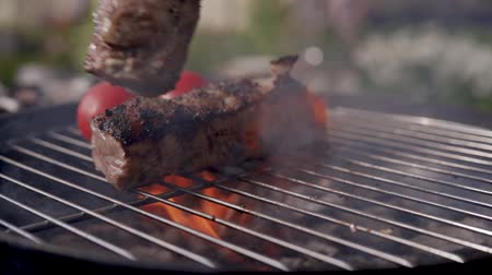 lombo de vaca : close up of cooking pork ribs on the grill barbecue Stock Footage