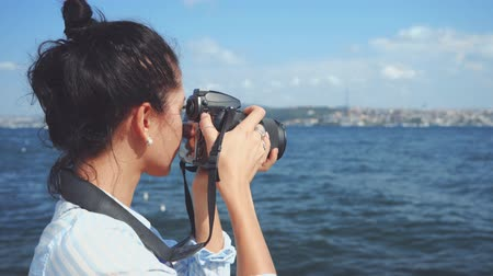 Woman photographer, taking pictures of landscape at sea Vídeos