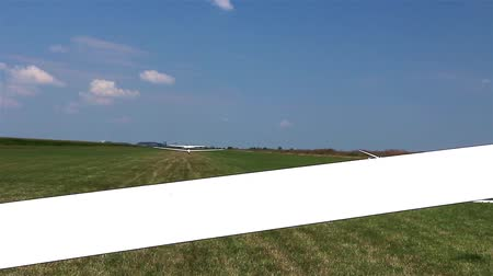 pulling off : Sailplane is launched via aero tow during a soaring contest. Stock Footage