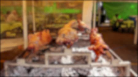porky : Lamb with two pigs is roasting on a spit. Roasting food is prepared for festivities to sale. Animals are over fire pit being automatically turned. Stock Footage