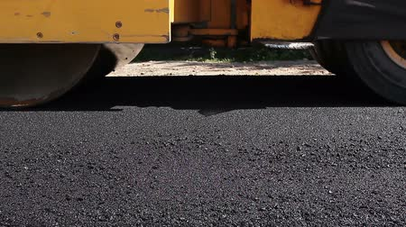 dengeleme : Hot asphalt is spreading with steamroller during road works.Steamroller are spreading, flatting hot asphalt.