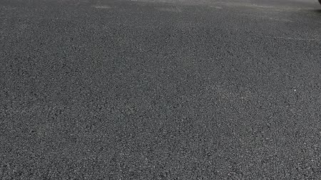 dengeleme : Steamroller is spreading, flatting hot asphalt. Hot asphalt is spreading with steamroller during road works. Stok Video