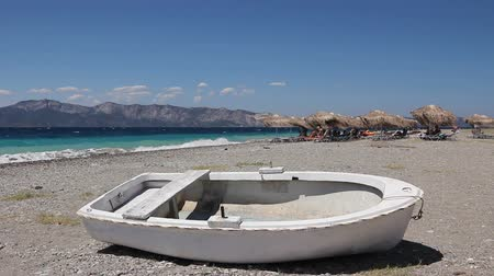 withdrawn : Small boat is dry docked, withdrawn at the beach, coastline.