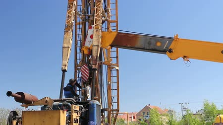 kladkostroj : Zrenjanin, Vojvodina, Serbia - April 23, 2015: Worker is showing coordinate to the crane with his hand.